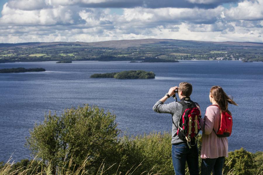 Couple enjoying a spectacular view overlooking Lough Derg