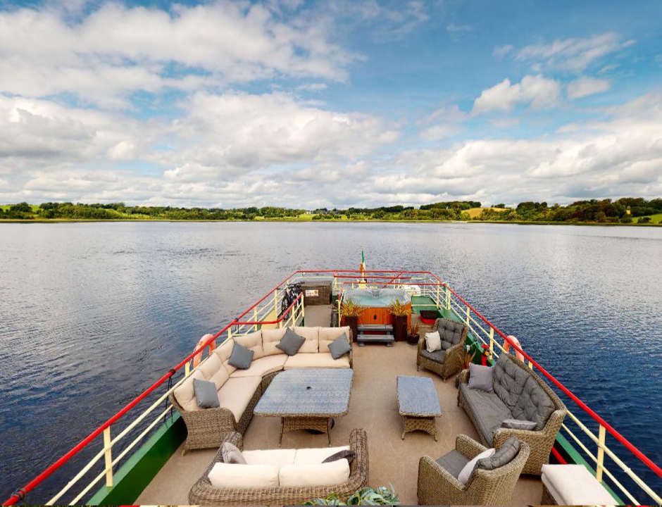 Shannon Princess deck with facilities for passengers and the river landscape in the background